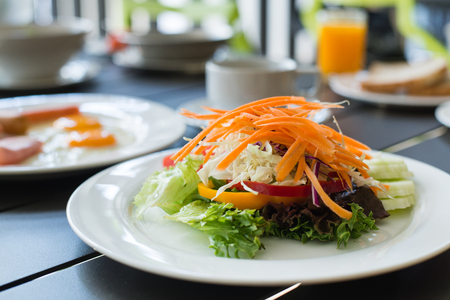 Breakfast salad with fried egg, ham and orange juice photo