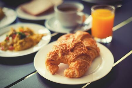 continental breakfast: Croissant Breakfast served with black coffee and orange juice Stock Photo