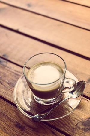mocha: Hot coffee, mocha brown wood table top. Stock Photo