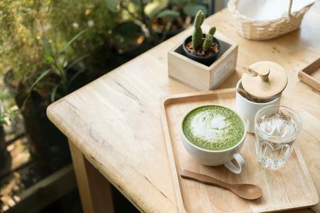 Hot green tea set on a wooden table in a coffeshop Reklamní fotografie