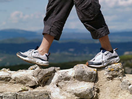 non moving activity: man hiking up a canyon
