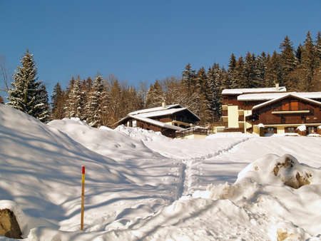 Megeve Ski Resort in French Alps, traditional hoses and firs under snow photo