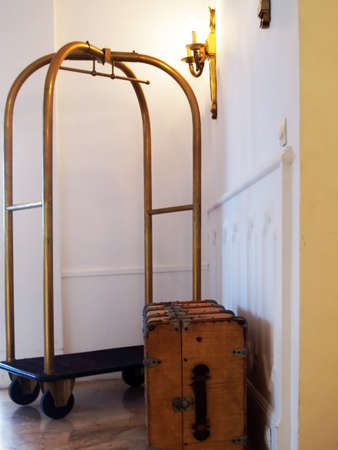 case and the Luggage Cart In the entrance of Luxury Hotel Stock Photo