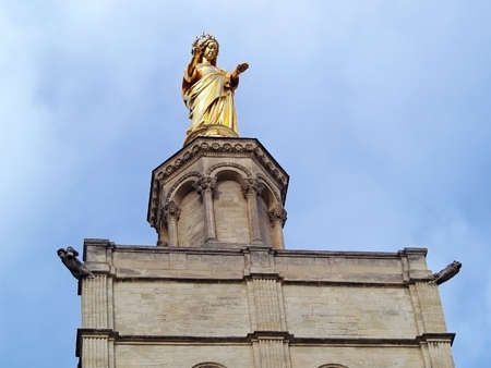 Virgin Mary protecting The Popes Palace in Avignon, France photo