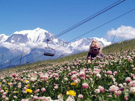 Young female sitting in white flowers behind the  Mont Blanc, -  the highest peak in Western Europe Stock Photo - 14177674
