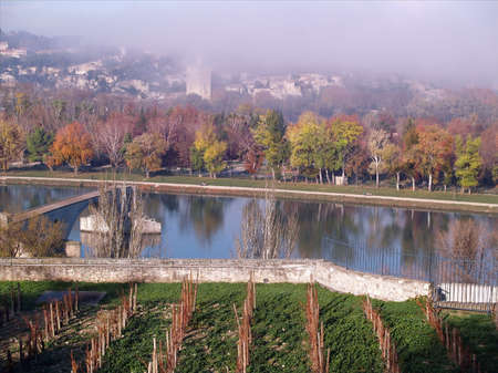 Avignon: the Bridge of St.-Benezet in a foggy day on autumn photo