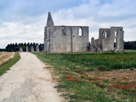 Dirt road leading to the ruins of an ancient cathedral on the island of ile de re,france. photo