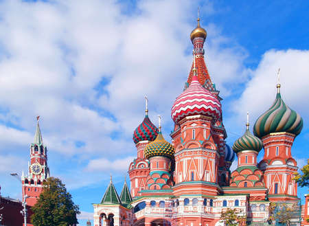 Red Square, Moscow, Russia  Saint Basil Cathedral and clock tower photo