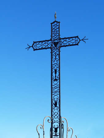 Christian cross against a blue sky in Chusclan, south of France Stock Photo - 15540733