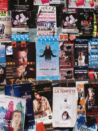 Plenty of playbills on a wall in Avignon during famous theatre festival