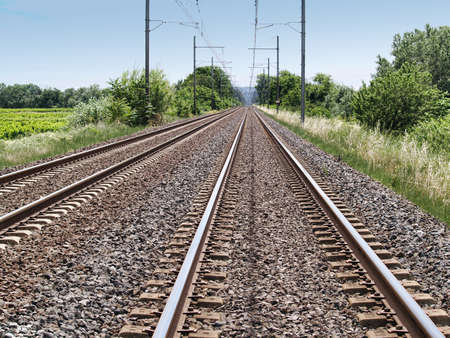 Railway lines in a rural area on summer day photo