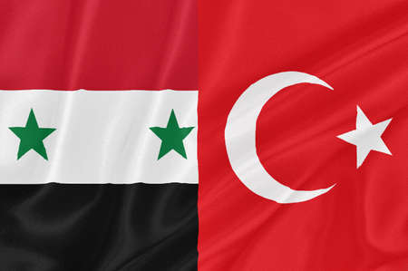arab spring: Flag of Turkey and flag of Syria waving with highly detailed textile texture pattern: representing a tention on Turkey-Syria border