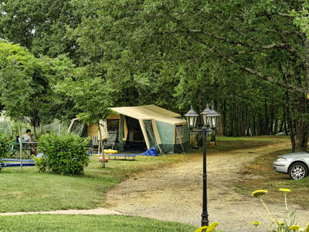 camping life with colorful tent and chairs