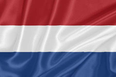Drapeau du Royaume des Pays-Bas en agitant avec motif textile texture tr�s d�taill�e Banque d'images