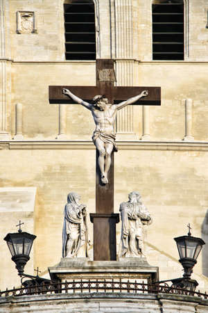 The Popes Palace in Avignon, France: Statues in front of the Notre-Dame des Doms Cathedral photo
