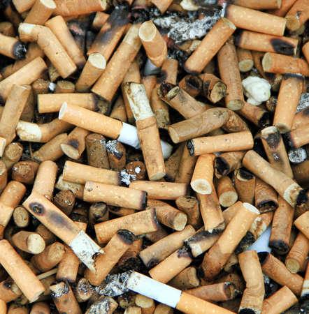 Bad addiction. Cigarette Butts Contexte Banque d'images