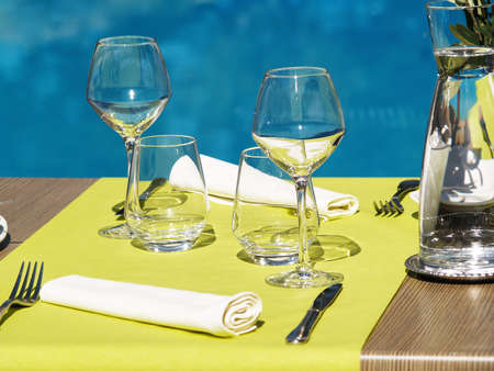 setting sun: Table setting in a restaurant for 2 persons pool-side