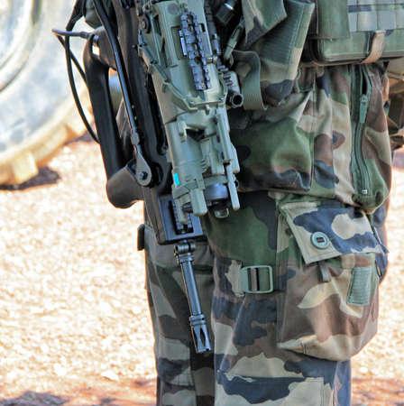 guerilla warfare: soldier with machine gun  Stock Photo