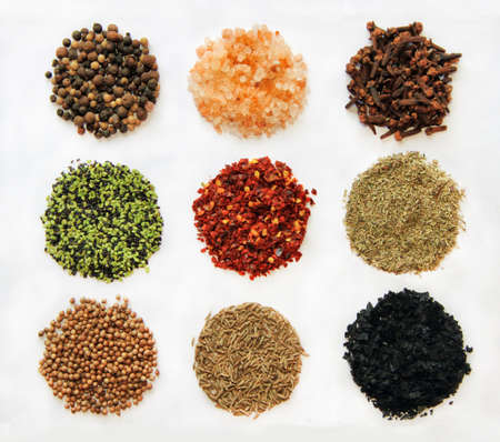 black peppercorn: variety of spices From left to right and up to down: Black Peppercorn,  himalayan salt,  clove,  sesame  ,  espelette chili, Provencal Herbs, coriander, cumin, black salt