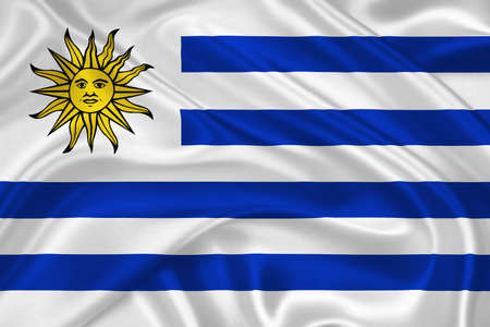 flag of Uruguay waving with highly detailed textile texture pattern photo