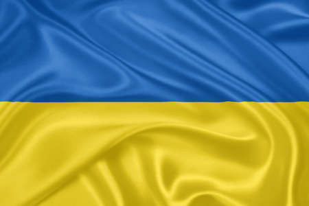 Flag of Ukraine waving with highly detailed textile texture pattern photo