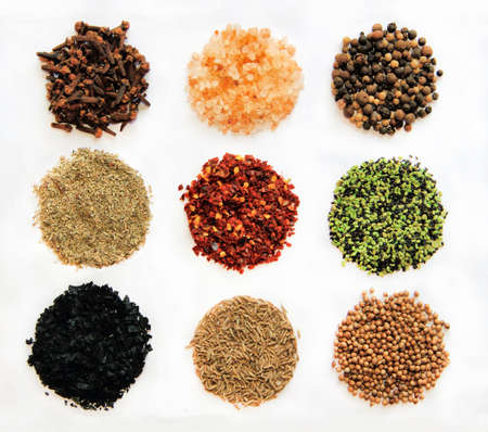 black peppercorn: variety of spicesFrom left to right and up to down  clove,  himalayan salt,  Black Peppercorn,  Provencal Herbs,  espelette chili, sesame , black salt, cumin, coriander