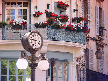 lampe: Scene with a historic clock in Old center of Avignon, France, Provence