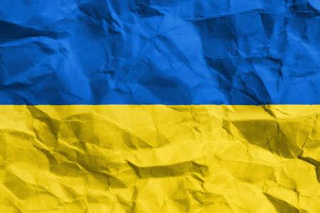 Ukraine crisis  Ukrainean flag on creased paper Stock Photo