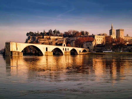 rhone: The Popes palace and the St.-Benezet bridge in Avignon, France view from the Bartelasse Island Editorial