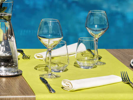 2 persons: Table setting in a restaurant for 2 persons pool-side  Stock Photo