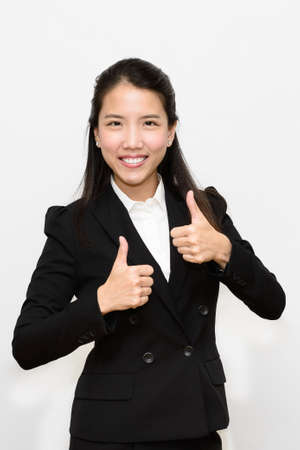 Thai business woman thumb up photo