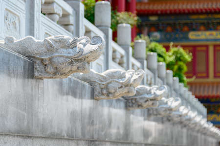 Chinese dragon head stone sculpture in a row photo