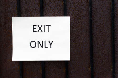 Exit Only Sign on a wood wall photo
