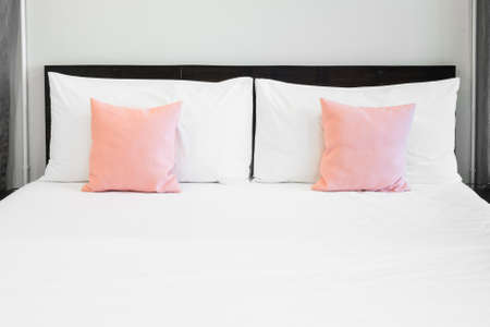 Bed and pink pillows photo