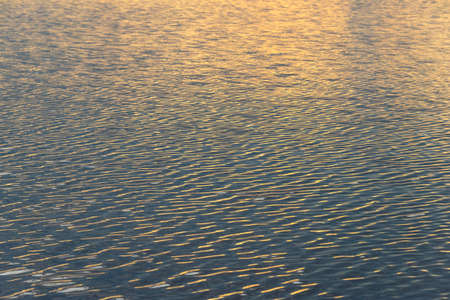 Water wave reflection with sun Banco de Imagens