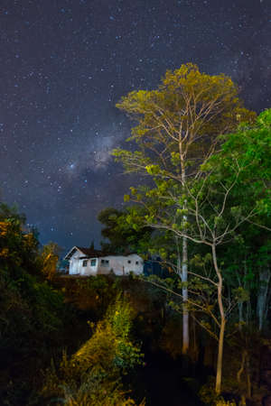 Milky way, house and trees