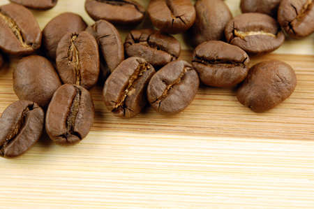 Roasted coffee beans on wooden with place for your text  Stock Photo - 9953137