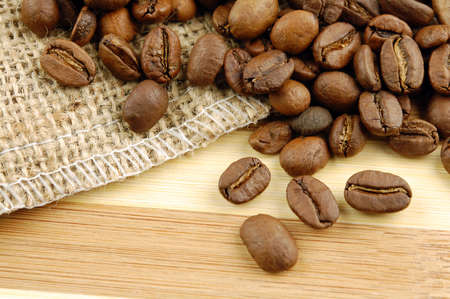 Coffee beans on sacking bag on desk with place for you text. Stock Photo - 9953146