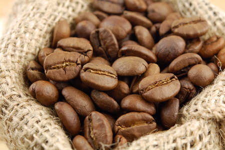 Roasted coffee beans in sacking bag. Selective focus. Stock Photo - 9953143