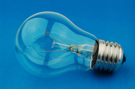 Electric light bulb on a blue background Stock Photo - 10119703