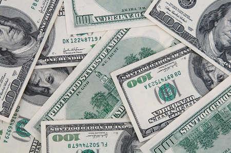 randomly: Background of American one hundred dollar bills lying randomly