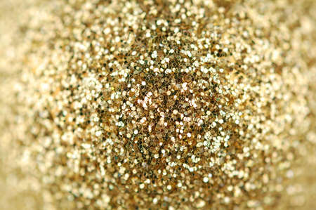 sparkles: Abstract background of gold sparkles on each side of the blurred Stock Photo