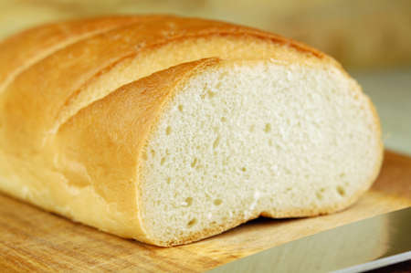 Close up of a long loaf on a cutting board Stock Photo - 10801348