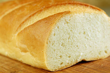 Close up of a long loaf on a cutting board Stock Photo - 10900062