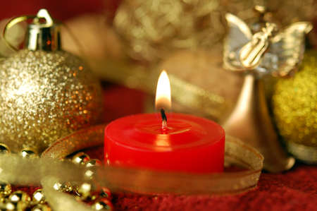 Candle and christmas decoration. Focus on a wick. Stock Photo - 11515341