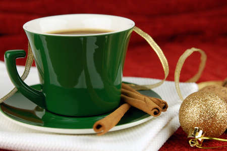Coffee cup with cinnamon and christmas decoration photo
