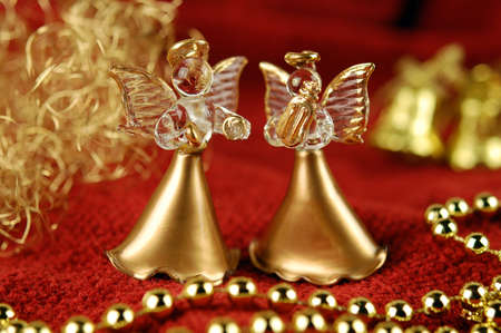 angel figurine: Two figurine of angels on the background of Christmas decorations