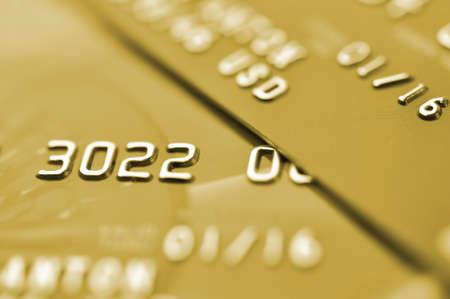 Credit cards in golden tone  Macro shot  Selective focus  photo