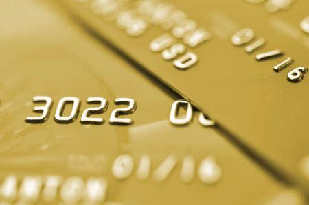 cash dispenser: Credit cards in golden tone  Macro shot  Selective focus
