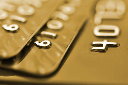 Debit cards in golden tone with shallow depth of field  Macro shot  Stock Photo